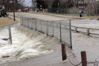 The Ness Avenue culvert, which always floods over each spring, won't be replaced with a bridge until 2015.