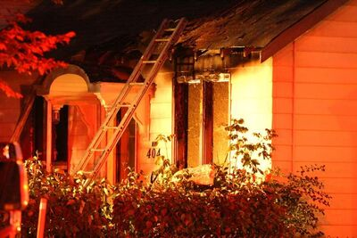 Fire engulfs a house in the 400 block of Manitoba Avenue Sunday night.  There was extensive damage done to the front of the house with flames reaching the roof.