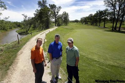 From left, Luke Wiebe, head pro Barry Gibson and Mike Greenwood, superintendent, on the strengthened dike along the Rat River at Maplewood Golf Club.