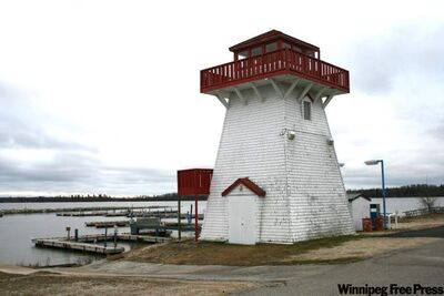 The iconic lighthouse stands watch over an empty marina, as all the boats had been pulled out for the winter by early November.