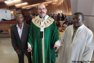 From left: Hector Gaglo, Archbishop Albert LeGatt and Father Andre Benengando.