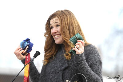 Clara Hughes shows off her Olympic medals at the site of the recreation park that will soon bear her name.