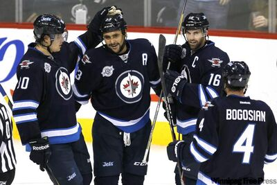 Winnipeg Jets' defenseman Dustin Byfuglien celebrates his goal against Philadelphia Flyers' goalie Sergei Bobrovsky with Nik Antropov, Andrew Ladd and Zach Bogosian during second period NHL action in Winnipeg on Saturday, November 19, 2011.