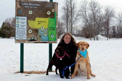 Kristy Greening, one of the Little Mountain Park Dog Club founders, enjoys a late winter's afternoon at the park with her dogs Kaleah and Kobe.