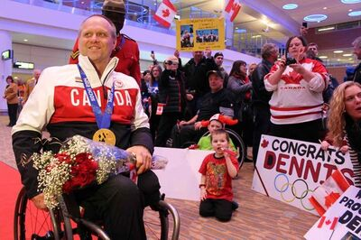 Sanford's Dennis Thiessen is greeted by well-wishers upon his return to Manitoba after winning gold in wheelchair curling at the 2014 Sochi Paralympic Games.
