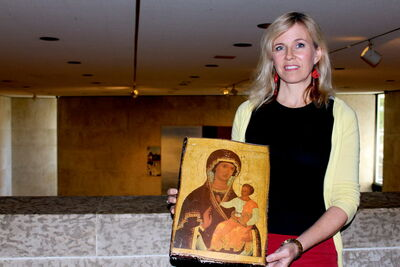 Art educator Rachel Baerg is pictured holding up an icon. The Mennonite Heritage Centre Gallery is hosting a new exhibit, Embracing the I-kon, from Sept. 20 to Nov. 9.