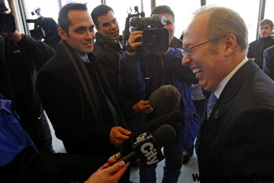 Winnipeg Mayor Sam Katz (right), outside his city hall office, demonstrates his enthusiasm for IKEA's plans to build a store in Winnipeg.