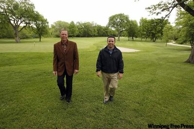 St. Charles Country Club superintendent Kerry Watkins, right, with general manager Cameron Gray, has an extensive game plan for getting and keeping the course ready.
