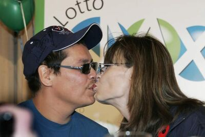 Marie and Kirby Fontaine kiss at a news conference where they picked up a $50-million Lotto Max cheque back in November 2009. The couple has donated significant amounts of their winnings to many charities in the province, including the Christmas Cheer Board and Siloam Mission.