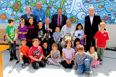 From left: Coun. Scott Fielding (St James–Brooklands), Brooklands School principal Rex Ferguson-Baird, Take Pride Winnipeg's Tom Ethans, Tyndall Park MLA Ted Marcelino, former city councillor Eldon Ross and Mayor Sam Katz with students from Brooklands School.