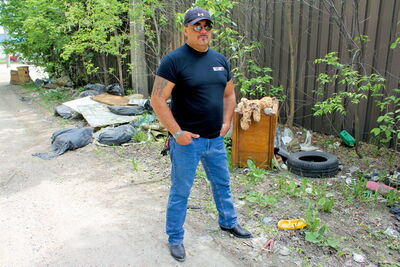 "James Favel of the Dufferin Residents Association says this spot in a Jarvis Avenue back lane is one of the worst spots for illegal dumping in the neighbourhood. ""This wasn't here five days ago,"" he says."