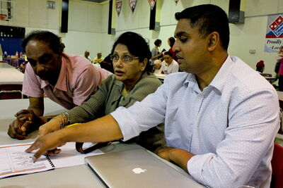 Manoj Nowrang (right) and Saraswati Sewpaul take part in a workshop on the planned expansion of Maples Community Centre last week.