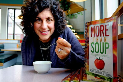 Wendy Erlanger enjoys a cup of soup over lunch last week. Erlanger recently released a new cookbook, More Than Soup, mixing nourishing soup recipes and advice for those feeling helpless to help a friend going through a serious illness like cancer.