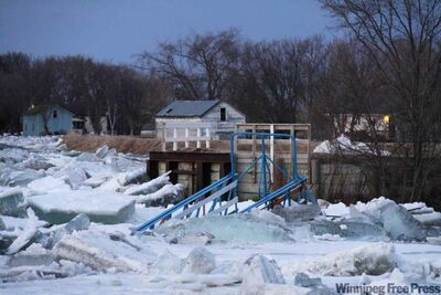Half of the footbridge across the Icelandic River in Riverton was swept away by ice overnight.