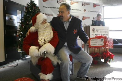 Wesmen men's basketball coach Dave Crook renews acquaintances with Santa, and hits him up for a championship.