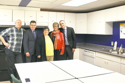 From left to right: Pat Leblanc, executive director of Teen Stop Jeunesse; Coun. Brian Mayes (St. Vital); Sharon Wachal, a local participant in programming for seniors; Nancy Allen, MLA for St. Vital and Minister of Children and Youth  Opportunities Kevin Chief in the kitchen at Teen Stop Jeunesse.
