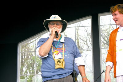 George Einarson addresses the crowd at his final Teddy Bears' Picnic as a key organizer on May 26.