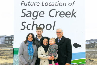 From left to right: Southdale MLA Erin Selby, Sage Creek residents Dale Hawthorne, Trish Cooling and their daughter, Isla, and Premier Greg Selinger at the site of Sage Creek's future school.