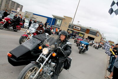 Bikers leave Polo Park Shopping Centre on the 5th annual Manitoba Motorcycle Ride For Dad last Saturday.