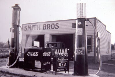 One of the photos used to promote the art show: The 1940s Smith Bros garage, with gravity pumps, was just east of where the Charleswood Bridge is today.