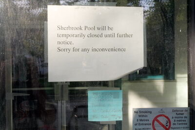 Sign inside door of Sherbrook Pool says it`s temporarily closed.