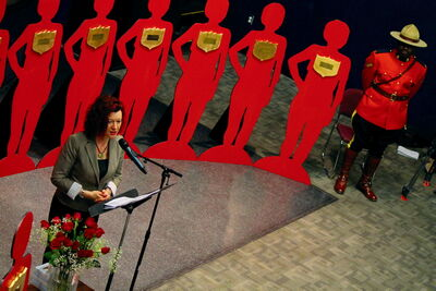 Kirkfield Park MLA Sharon Blady shared her own domestic violence story before family members of murdered women, represented in silhouettes, did the same.