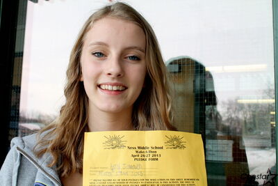 Ness Middle School student Amy Jansen has raised $500 and counting for CancerCare by taking pledges door-to-door for her school's upcoming wake-a-thon.