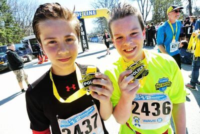 Matt Soltys, 12 (left), and Scott English, 13, are the youngest to finish the half-marathon at Assiniboine Park Sunday.