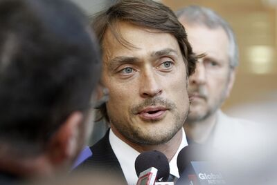 Teemu Selanne speaks with media at the funeral for Don Baizley at the MTS Centre Wednesday.
