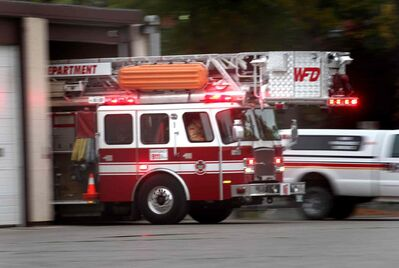 City firefighters respond to call from the city's Station No. 1 downtown Wednesday evening.