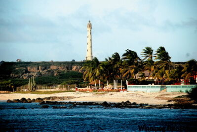 The California Lighthouse rises near the northernmost part of Aruba.