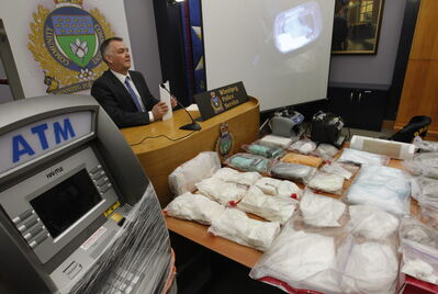 Winnipeg Police Staff Sgt. Rob Harding with items obtained in Project Sideshow in February. Now, troubling questions have emerged about a former federal prosecutor's role in the case — one of the largest undercover organized-crime investigations ever undertaken by Winnipeg police.