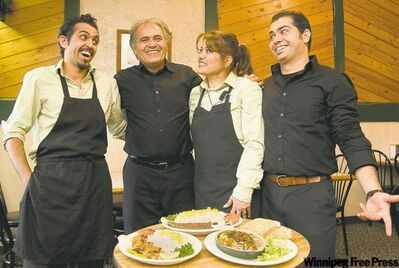 From left, Saman Jafari, Morteza Jafari, Farahnuz Mehran and Siamak Jafri at the family operated Darakeh Restaurant in St. Adolphe.