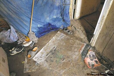 Filthy floors and rotting walls are grim reality for the 13 people who call  Richard  Andrews' rundown trailer home.