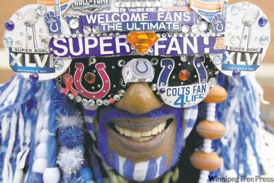 Mark Humphrey / the associated pressMichael Hopson is decked out as �Super Fan� as he walks through Super Bowl Village on Friday in downtown Indianapolis.