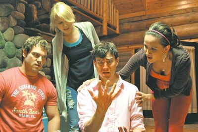 "Shawn Roberts, Kristen Hager, Kristopher Turner, Crystal Lowe, left to right, are pictured in a scene from the movie A Little Bit Zombie. Toronto-based director Casey Walker set up his own website to generate financing for his $2-million horror-comedy, ""A Little Bit Zombie,"" and says he collected $120,000 from roughly 800 donors around the world. THE CANADIAN PRESS/ HO"