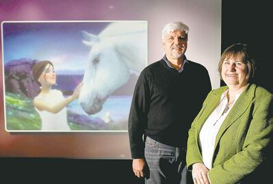 @None:Phyllis Laing, president of Buffalo Gal Pictures and Opus Visual Effects and Dan Krech, president of Entremedia with a scene from the feature film called Emma's Wings: A Bella Sara Tale at the the news conference Tuesday.  (WAYNE GLOWACKI/WINNIPEG FREE PRESS)