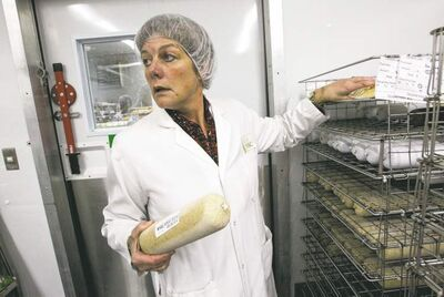 Kathleen Richardson says the facility assembles and distributes more than 8,000 meals each day for most city hospitals and nursing homes.