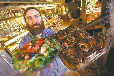 At Common Sense, manager Kepha Verrier shows off spectacular sweet cinnamon rolls and a cranberry-nut salad.