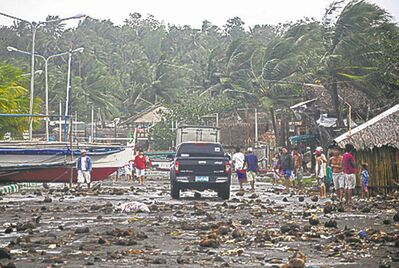 Debris litter the road by the coastal village in Legazpi city.