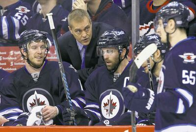 TREVOR HAGAN / WINNIPEG FREE PRESSHead coach Paul Maurice gives some pointers to Bryan Little (left) and Andrew Ladd on Saturday night.