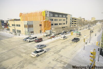 Winnipeg Regional Health Authority's new building on Main Street (above) looks dramatically different than the artist's design from March 2008 (below).
