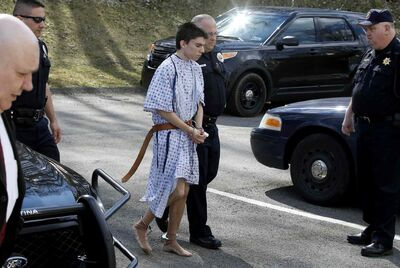 Alex Hribal, the suspect in the multiple stabbings at the Franklin Regional High School in Murrysville, Pa., is escorted by police to a district magistrate to be arraigned on Wednesday, in Export, Pa.
