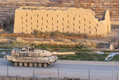 A Leopard 2 tank travels on a highway in the Panjwaii district in this Nov. 17, 2008 photo. THE CANADIAN PRESS/Bill Graveland