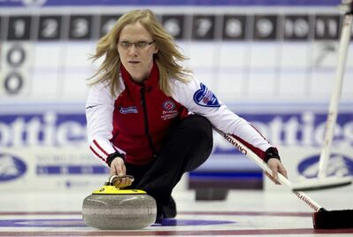 Team Canada skip Amber Holland makes a shot during a draw against team Newfoundland and Labrador at the Scotties Tournament of Hearts in Red Deer, Alberta, Saturday, Feb. 18, 2012.  THE CANADIAN PRESS/Jonathan Hayward