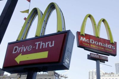 FILE - In this Dec. 20, 2010 file photo, McDonald's signs sprout from the restaurant's parking lot in New York. McDonald's said Monday, Jan. 24, 2011, its fourth-quarter net income rose 2 percent as it brought in more customers with its McRib sandwich and an addition to its successful McCafe coffee lineup. (AP Photo/Richard Drew)