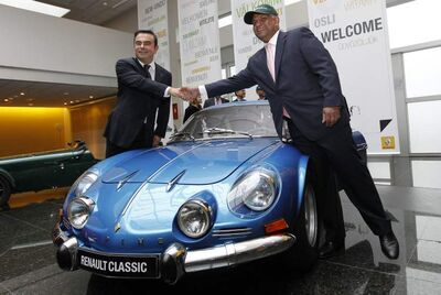 Renault CEO Carlos Ghosn, left, with Caterham CEO Tony Fernandezand classic Alpine sports car at Renault headquarters in Paris.