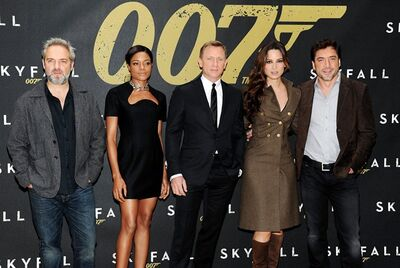 "Director Sam Mendes, left, poses with actors Naomie Harris, Daniel Craig, Berenice Marlohe and Javier Bardem during a photo call for the new James Bond film ""Skyfall"" at the Crosby Street Hotel on Monday Oct. 15, 2012 in New York. (Photo by Evan Agostini/Invision/AP)"