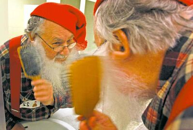 In this file photo, Stu Ritterman, a previous Festival du Voyageur Beard Growing Contest entrant combs through his beard.