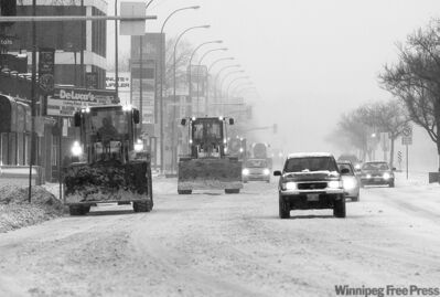 Snowplows get busy cleaning snow off Portage Avenue on Christmas Day. At left, Matt and Chris Jackson, Binxiang Zhao, Arthur  Buchanan, and Bob Jackson (from left) get together to play some hockey at The Forks.